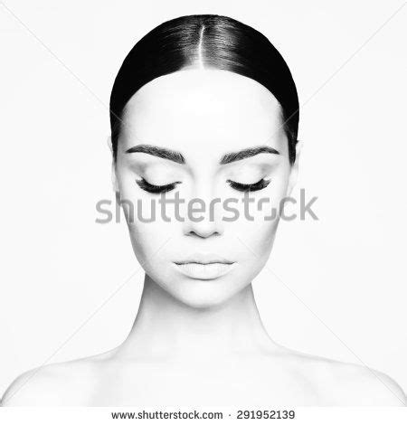 Black and white studio portrait of beautiful young woman
