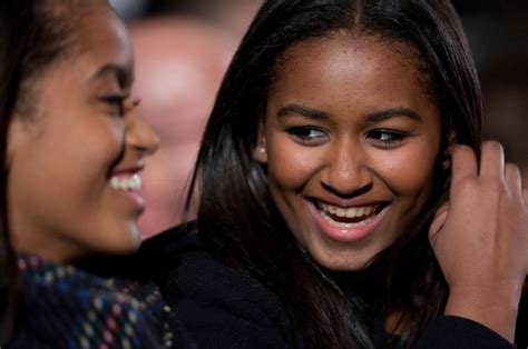 Sasha Obama graduates from high school as parents watch on